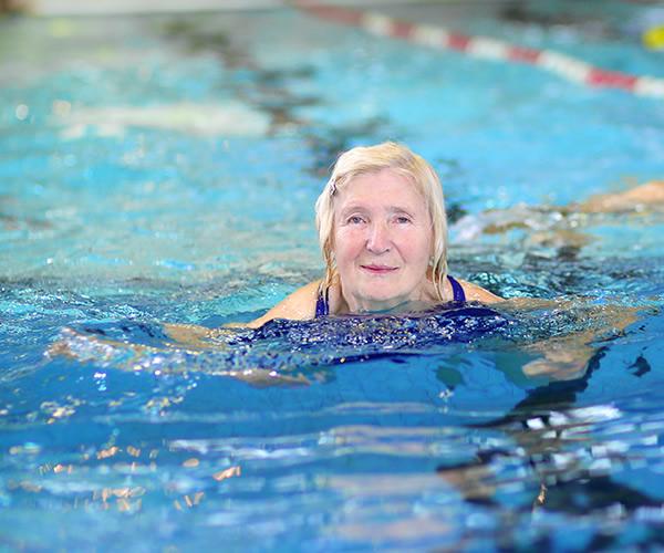 Healthy senior woman in swimming pool